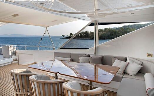Motor Yacht POZITRON Aft Deck Dining Table