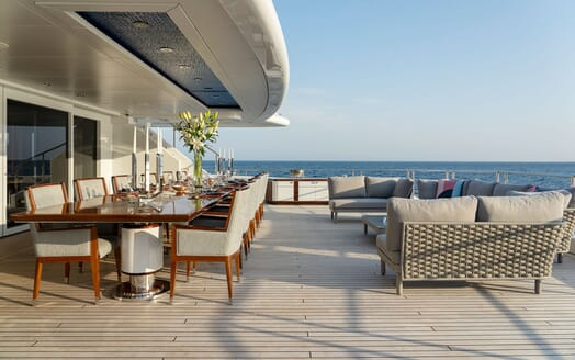 Motor Yacht ILLUSION PLUS Aft Deck Dining Table