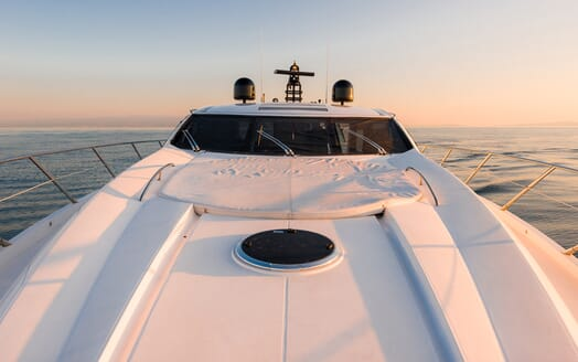 Motor Yacht GLORIOUS bow shot yacht on water