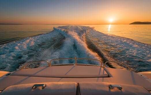 Motor Yacht GLORIOUS stern shot at sunset