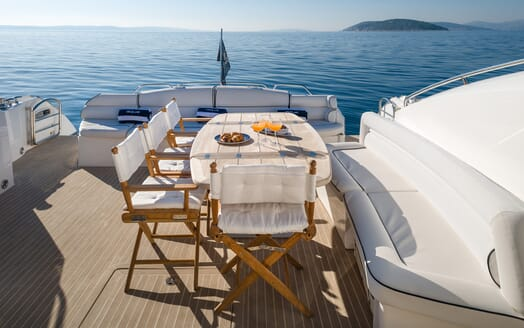 Motor Yacht GLORIOUS sunny deck shot with breakfast on table overlooking the sea