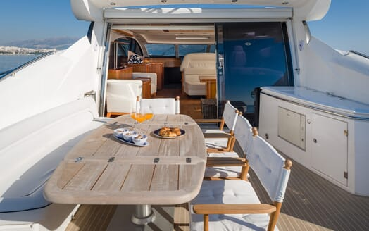 Motor Yacht GLORIOUS reverse deck shot table with breakfast