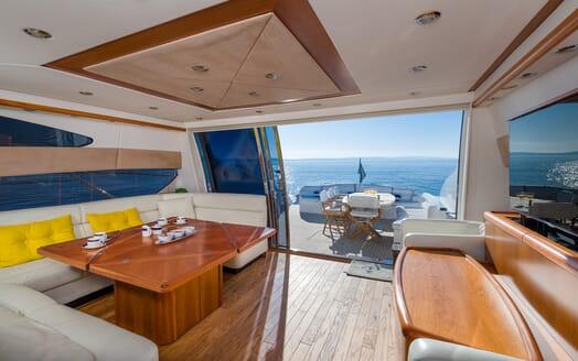 Motor Yacht GLORIOUS indoor dining area with deck door open