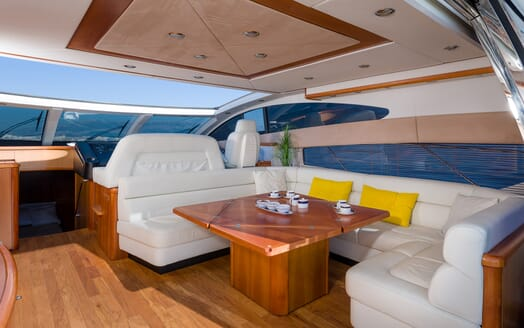 Motor Yacht GLORIOUS indoor deating area white leather and yellow pillows large windows