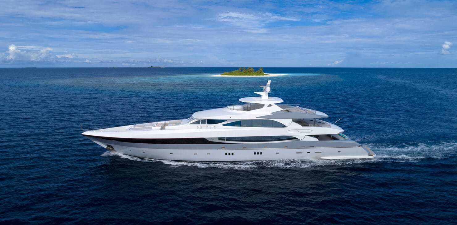 Motor yacht SEAREX hero shot with small island in background