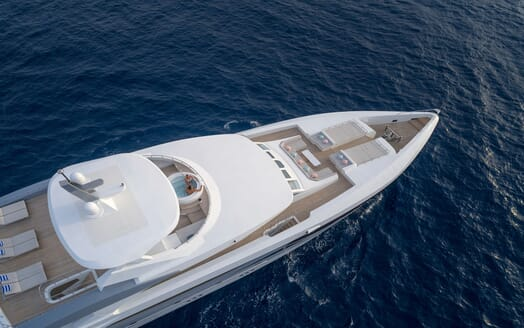 Motor yacht SEAREX hero shot with couple in top deck jacuzzi