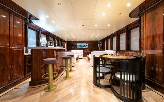 Motor Yacht BLUE MAGIC Main Deck Saloon Bar and Games Table
