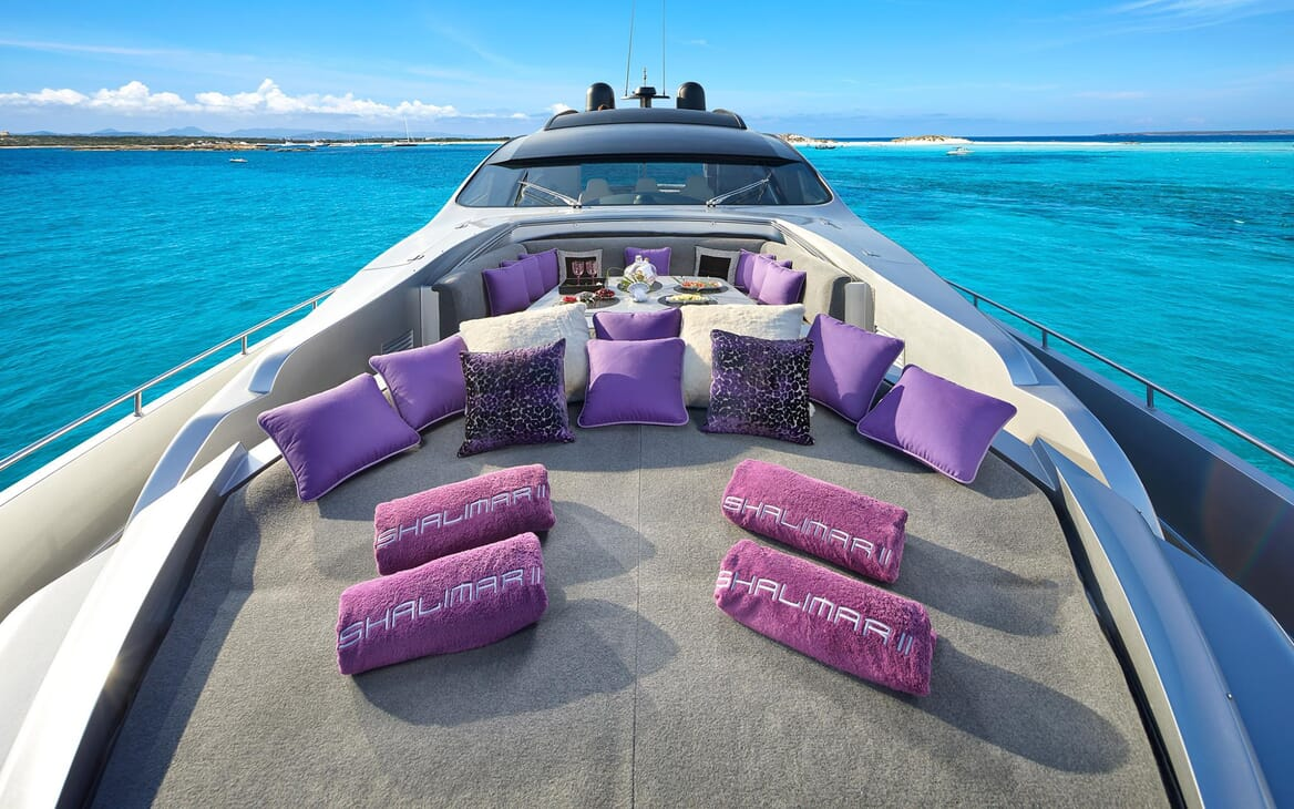 Motor Yacht SHALIMAR II bow shot of seating area with purple cushions