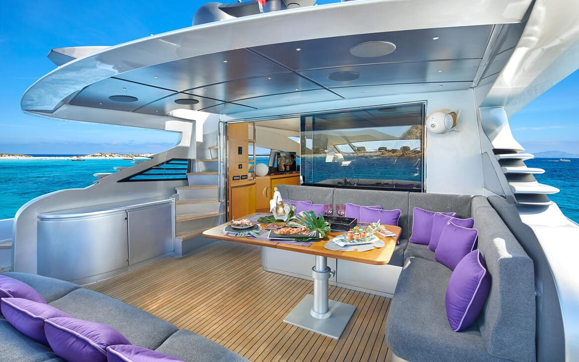 Motor Yacht SHALIMAR II deck shot with seating area with purple and grey furnishings for alfresco dining