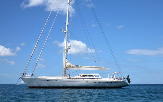 Sailing Yacht Sea Breeze Side hero shot on water