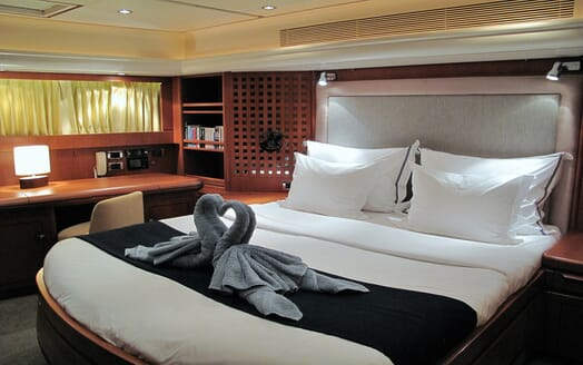 Sailing yacht SEA BREEZE master suite with white sheets and swan towel motif