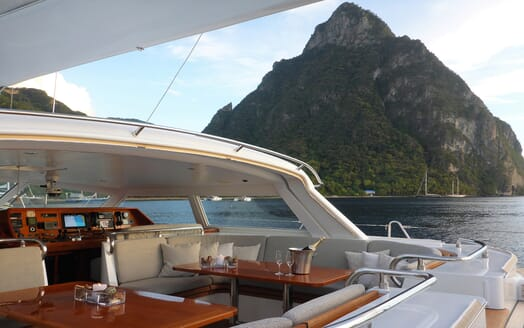 Sailing yacht SEA BREEZE outdoor seating area with sea and mountain views