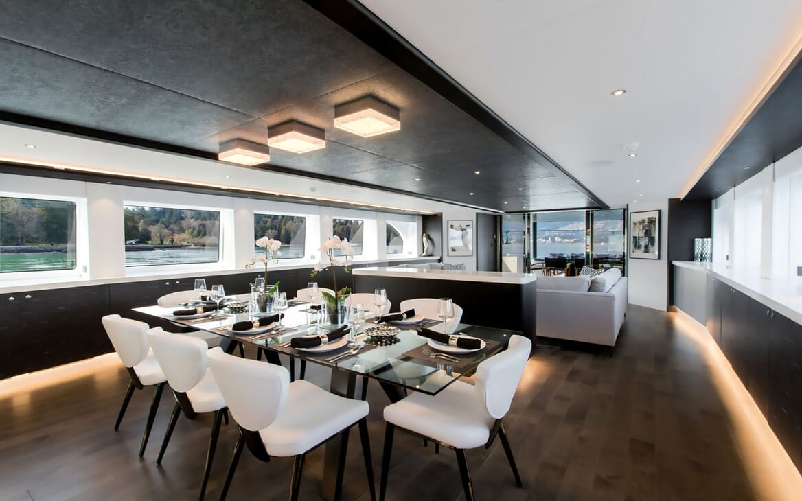 Motor yacht CRESCENT 117 contemporary dining room with black ceiling, soft lighting and grey furnishings