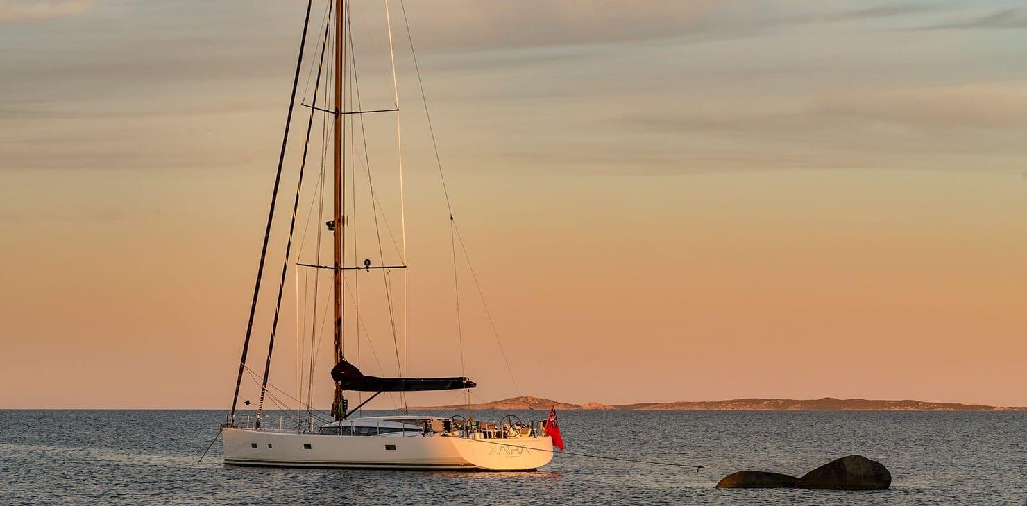 Sailing Yacht XAIRA hero shot on water at dusk