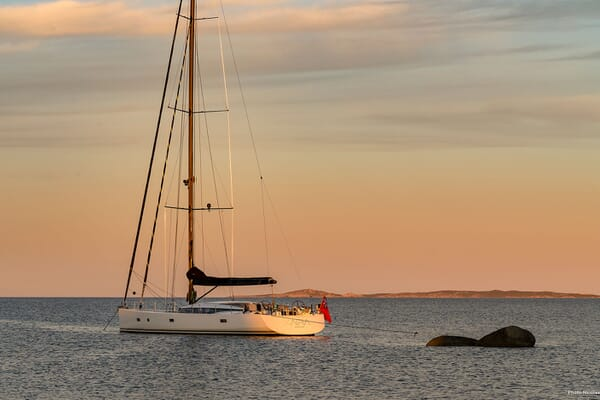 Sailing Yacht XAIRA hero shot on water at dusk