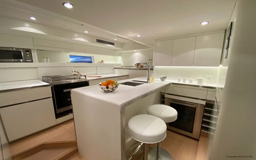 Sailing Yacht XAIRA kitchen with contemporary interiors and soft lighting
