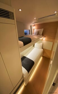 Sailing Yacht XAIRA twin stateroom with contemporary interiors and soft lighting