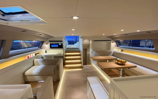 Sailing Yacht XAIRA aerial dining area with contemporary interiors and soft lighting