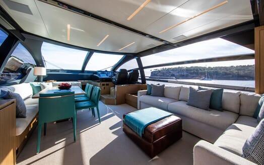 Motor Yacht JULIA S Main Deck Saloon, Dining Table and Wheelhouse
