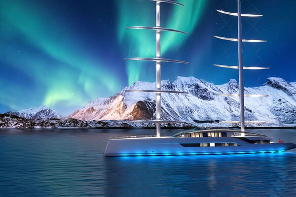 Motor yacht NEW DAWN hero shot on water with blue lighting and Northern lights in background