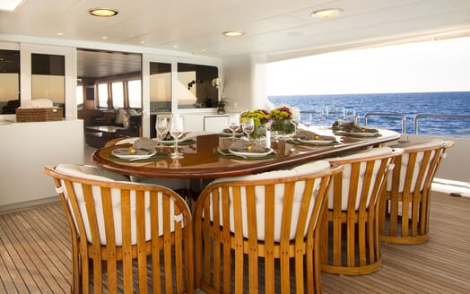 Motor Yacht SERENITY 122 Main Aft Deck Dining Table
