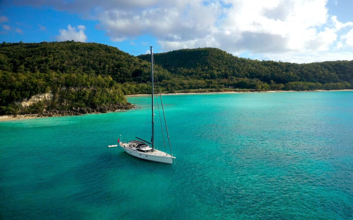 Sailing Yacht CHAMPAGNE HIPPY At Anchor Landscape