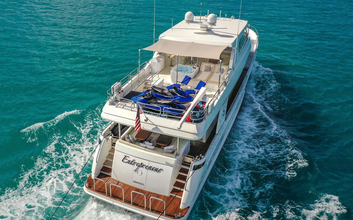 Motor Yacht ENTREPRENEUR 100 Aerial Aft View with Jetskis