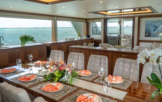 Motor Yacht ENTREPRENEUR 100 Main Deck Dining Table Set Up