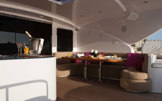 Motor yacht deck shot of alfresco dining area