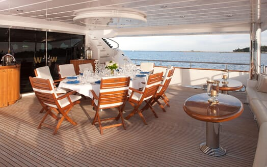 Motor yacht WHEELS I deck shot with alfresco dining table and chairs
