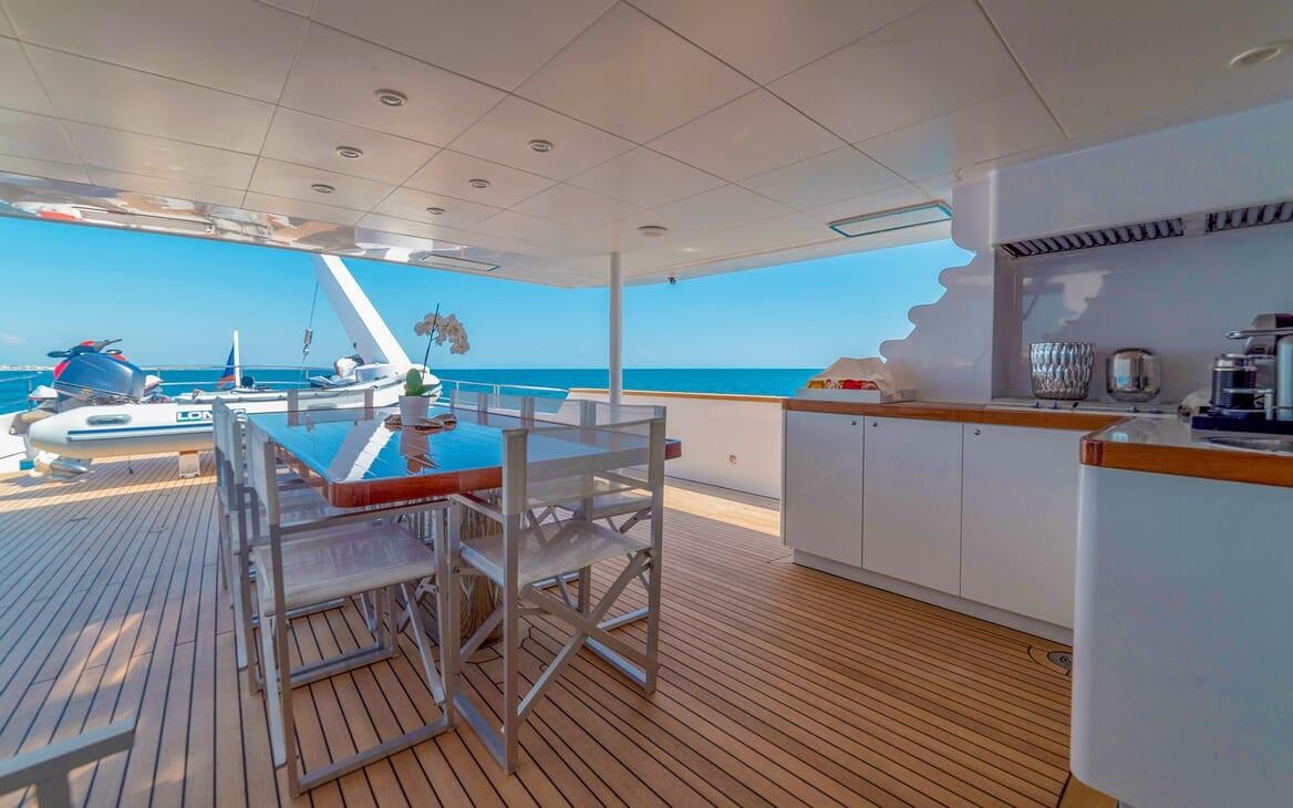 Motor Yacht Berzinc Aft Deck Table