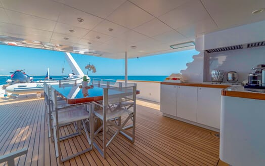 Motor Yacht Berzinc Aft Deck Table