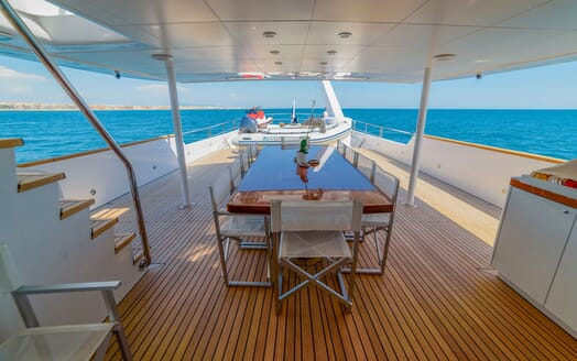 Motor Yacht Berzinc Aft Deck Dining Table