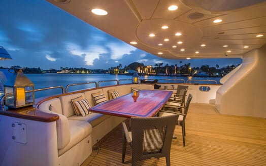Motor Yacht BELIEVE Upper Deck Aft with Dining Table