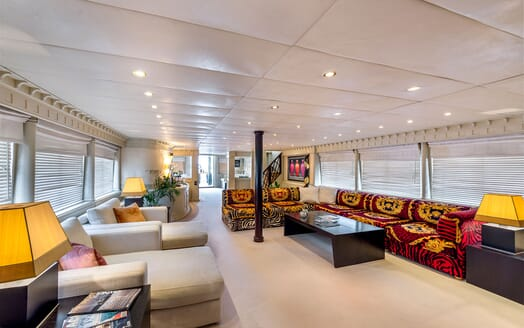 Motor yacht Superfun cream carpeted living room with zebra print sofa