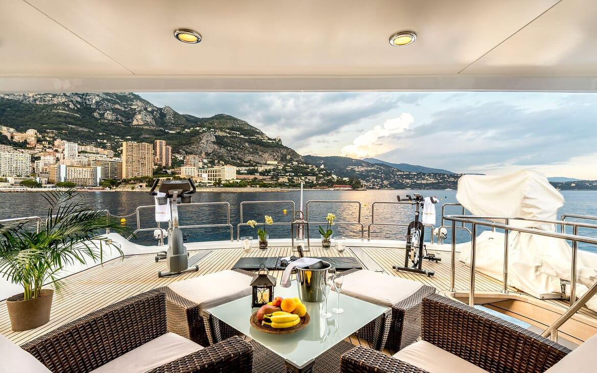 Motor yacht Superfun beach club with exercise equipment with views of the monaco coastline