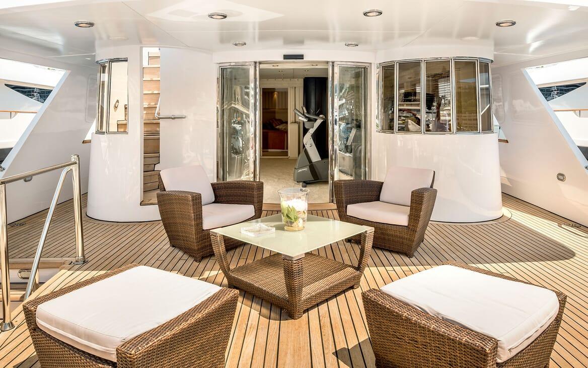 Motor yacht Superfun decking with wicker outdoor furniture