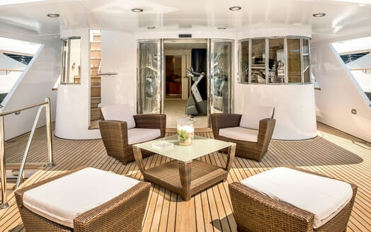 Motor yacht Superfun decking with wicker outdoor furniture