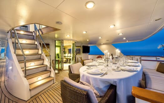 Motor yacht Superfun alfresco dining area with laid table