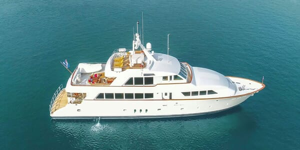 Motor yacht KIMBERLY hero shot on turquoise water