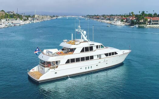 Motor yacht KIMBERLY hero shot on turquoise water