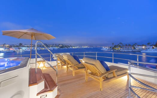 deck with sun loungers and jacuzzi