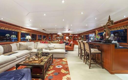 Motor yacht KIMBERLY main living area with dark wood furnishings