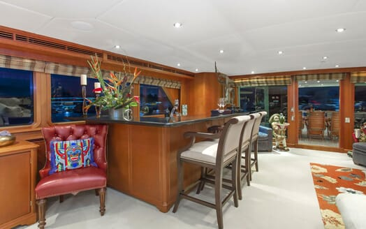 Motor yacht KIMBERLY dark wood bar with high foot stools