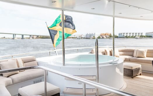 Motor Yacht NICOLE EVELYN Jacuzzi with Flag