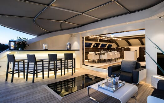 Motor Yacht TATII Dining Table to Deck With Bar
