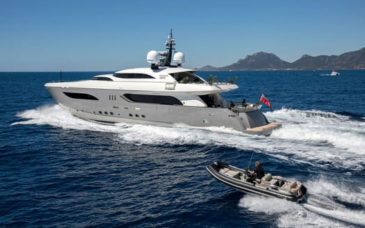 Motor Yacht TATII Exterior underway with Tender