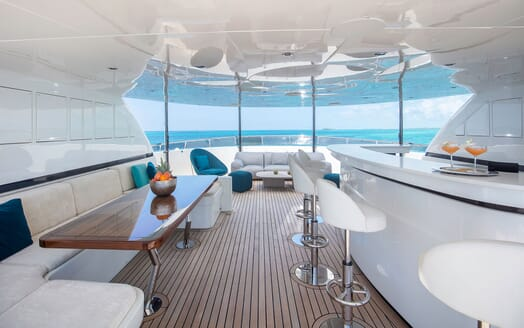 Motor Yacht MYSTIC Sun Deck Table and Bar