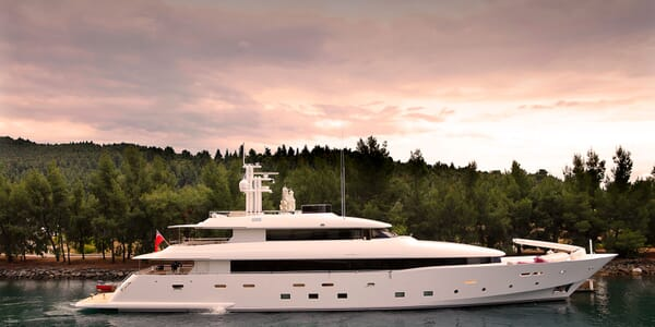 Motoryacht MR MOUSE hero shot with moody landscape