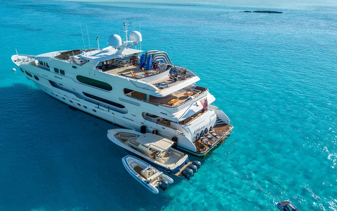 Motor yacht MILESTONE aerial shot on turquoise water and tender
